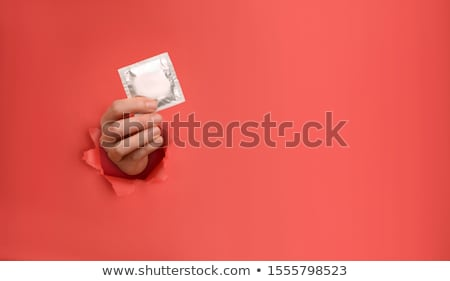 A red condom Stock photo © bluering