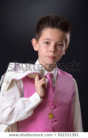 Young boy holding his jacket over his shoulder in his First Holy Stock photo © BigKnell