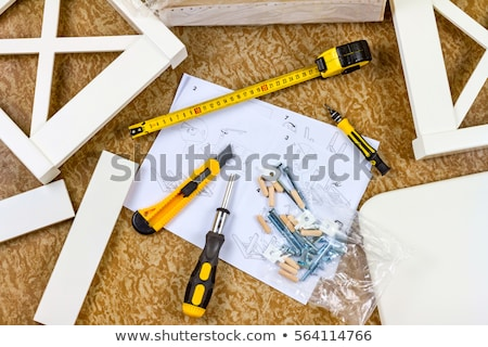 Man assembling furniture at home, hand with wooden dowel pins Stock photo © stevanovicigor
