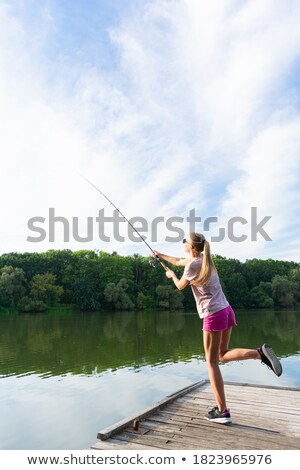 Woman with long hair in swimwear standing on pier Stock photo © deandrobot
