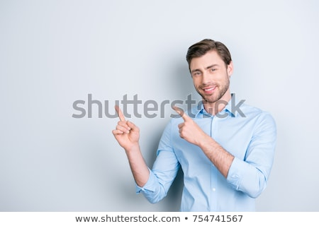 smiling businessman pointing with his forefinger stock photo © rastudio