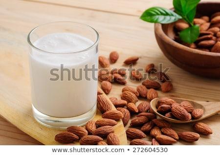 amêndoa · leite · tabela · vidro · em · torno · de - foto stock © icemanj