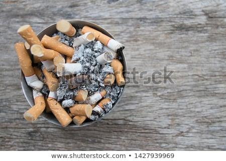 Vuile asbak houten tafel tabel roken sigaret Stockfoto © Digifoodstock