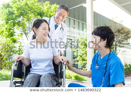 smiling japaneses doctor stock photo © elwynn