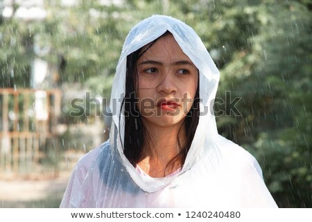 Belo jovem senhora capa de chuva transparente Foto stock © konradbak