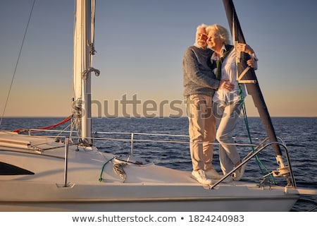 amazing woman standing on the yacht stock photo © deandrobot
