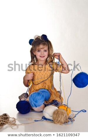 Little baby girl playing with threads ball. Stock photo © deandrobot