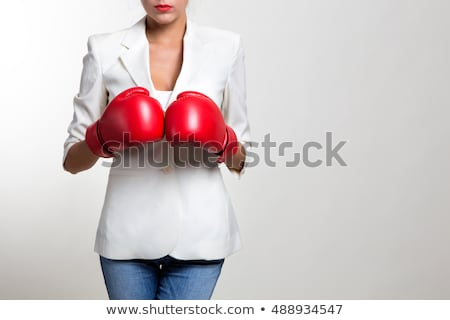 Angry Businesswoman Wearing Boxing Gloves Isolated Stock photo © Qingwa