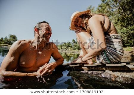 Férfi nő tó idő víz család Stock fotó © tekso