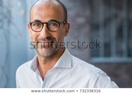 Gelukkig zakenman naar camera tevredenheid geïsoleerd Stockfoto © julenochek