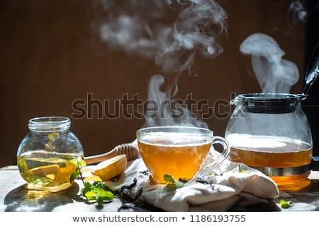 Glass teapot and cup with tea Stock photo © JanPietruszka