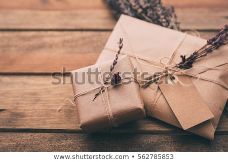 Christmas composition with presents wrapped in craft paper  Stock photo © dariazu