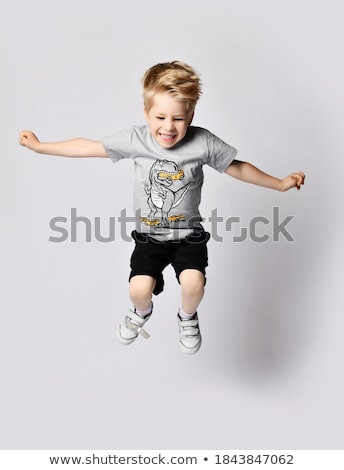 Boy, 7 playing on trampoline Stock photo © IS2