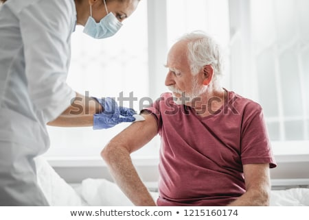 Doctor with syringe in hospital ward. Stock photo © RAStudio
