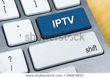 Keyboard with Blue Button - Iptv. Stock photo © tashatuvango