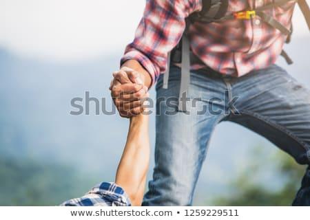 couple teamwork man and woman helping hand on hike stock photo © blasbike