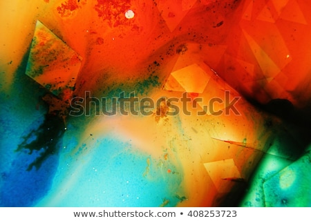 green ink colors in water creating liquid art shapes stock photo © diego_cervo