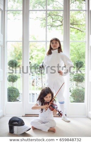 girls with violin and fencing gear stock photo © is2