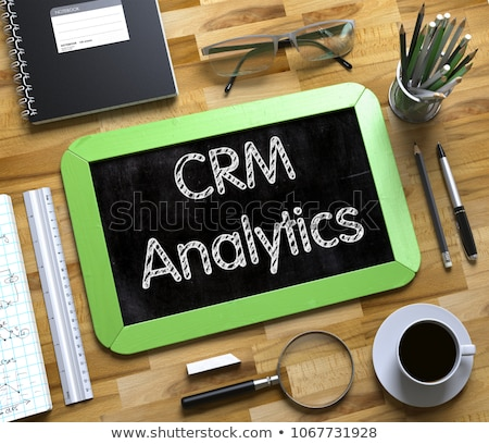 CRM Analytics Handwritten on Small Chalkboard. Stock photo © tashatuvango