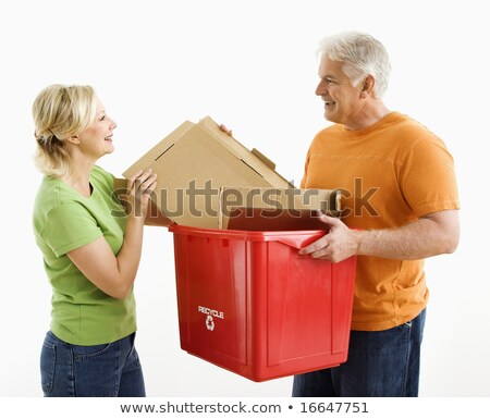 couple placing papers in a recycle bin stock photo © is2