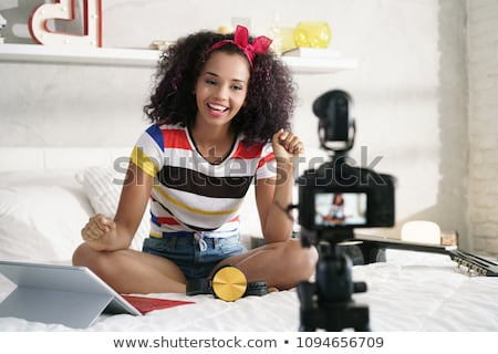 dslr camera for woman recording vlog and tutorial stock photo © diego_cervo