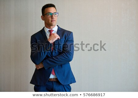 handsome businessman wearing navy suit and glasses standing and  Stock photo © feedough