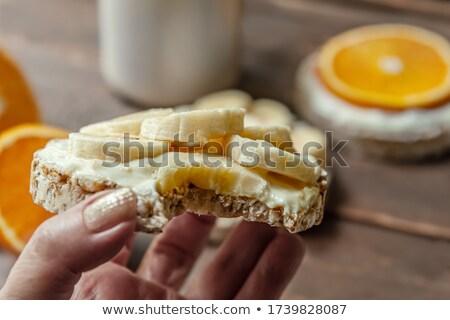 Female hands slicing homemade multigrain bread Stock photo © Melnyk