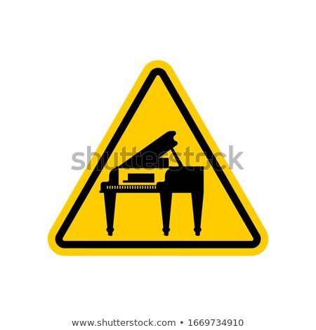 Attention piano. Yellow prohibitory triangular road sign. Cautio Stock photo © MaryValery