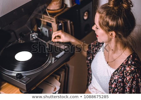 young woman with vinyl record stock photo © studiostoks