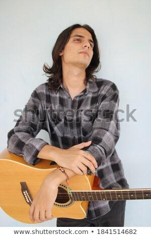 моде человека позируют электрической гитаре Сток-фото © feedough