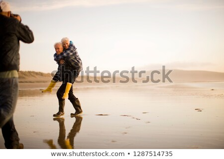 Man Giving His Wife Piggy Back Ride Stock photo © monkey_business