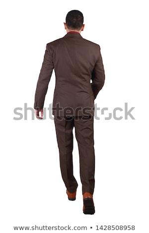 Blick zurück junger Mann Smoking Fuß weiß Mann Stock foto © feedough