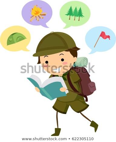 Criança menino escoteiro ler camping livro Foto stock © lenm