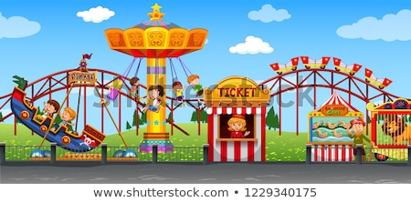 Happy childen at fun fair Stock photo © bluering