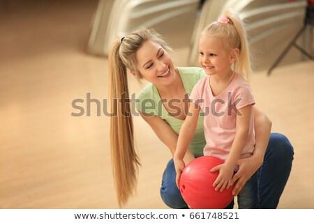 Anne kız oynama bowling oyun Stok fotoğraf © Kzenon