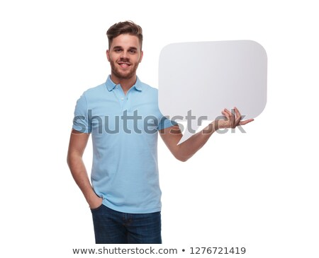 portrait of relaxed man wearing polo shirt holding speech bubble Stock photo © feedough