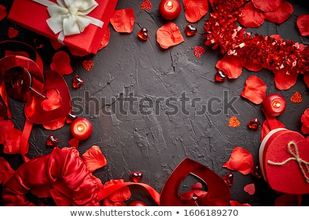 Red roses petals, candles, dating accessories, boxed gifts, hearts, sequins Stock photo © dash