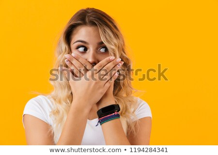 Photo of surprised blond woman in basic clothing covering mouth  Stock photo © deandrobot