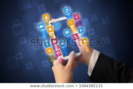 Hand using smartphone with angular app icons Stock photo © ra2studio