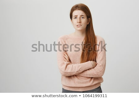 Stock photo: Portrait of a worried young woman standing