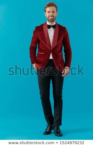 groom guy in blue tuxedo walking with hand in pocket Stock photo © feedough