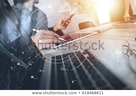 Group of people with devices in hands working on laptops and tablets with online teamwork concept Stock photo © ra2studio