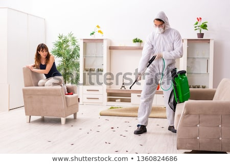 Foto stock: Young professional contractor doing pest control at flat
