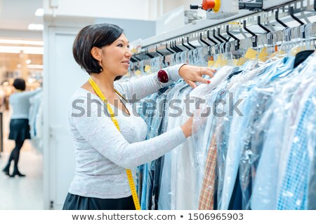 Small business owner woman in a textile cleaning shop Stock photo © Kzenon
