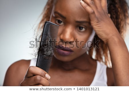 Shocked Woman Suffering From Hair Loss Problem Stock photo © AndreyPopov