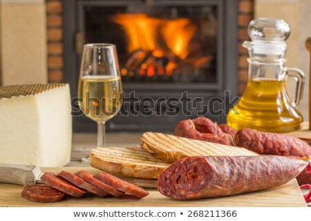 Spanish chorizo sausage with knife on wooden board Stock photo © Melnyk