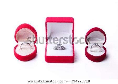 golden wedding rings in front of red heart stock photo © andreypopov