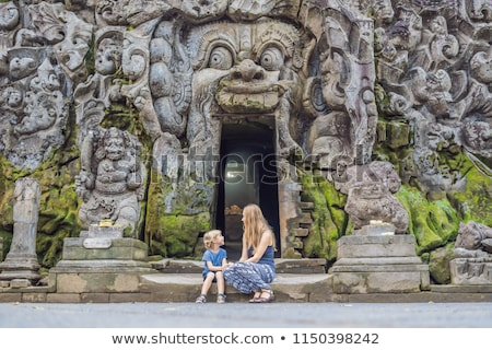 Mom and son are tourists in Old Hindu temple of Goa Gajah near Ubud on the island of Bali, Indonesia Stock photo © galitskaya