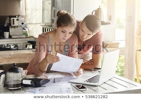 Pareja factura calculadora sonriendo alfombra Foto stock © AndreyPopov