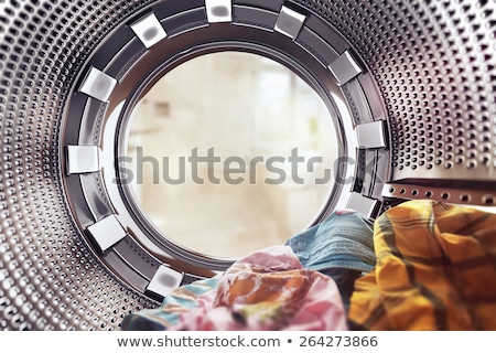 washing machines with clothes inside at laundromat Stock photo © dolgachov
